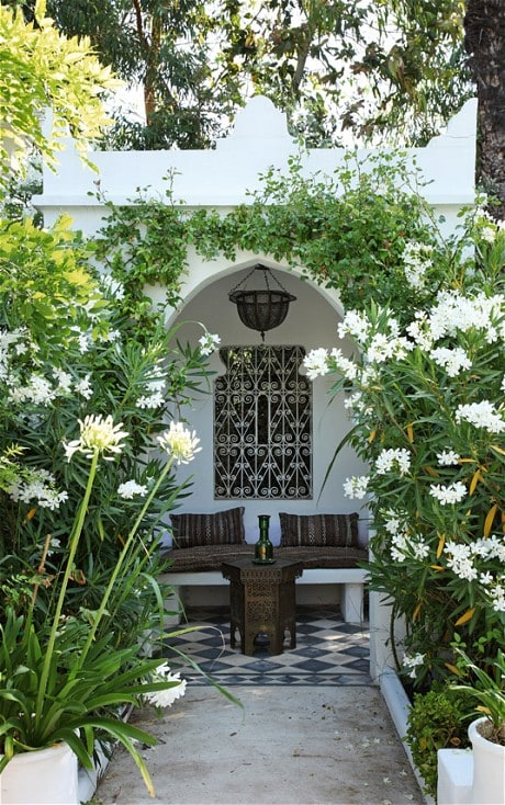 A Moroccan tea pavillion made spectacular by the white agapanthus and oleander leaning into the walkway. (Photo: Jean-Francois Jaussaud)
