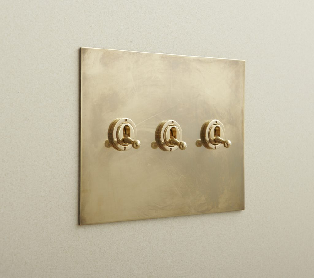 My aesthetically-minded client specified these unlacquered brass toggle switches from Forbes and Lomax. (Photo: Forbes and Lomax)