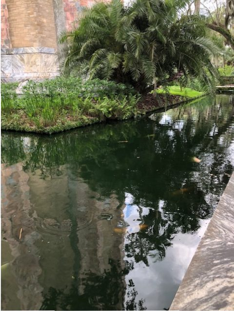 A koi-filled moat surrounds the tower, Bok Tower Gardens, Lake Whales, Florida.
