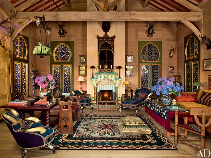 The salon with pine paneled walls and antique stained-glass doors recalling Morocco. (Photo: Pascal Chevallier)