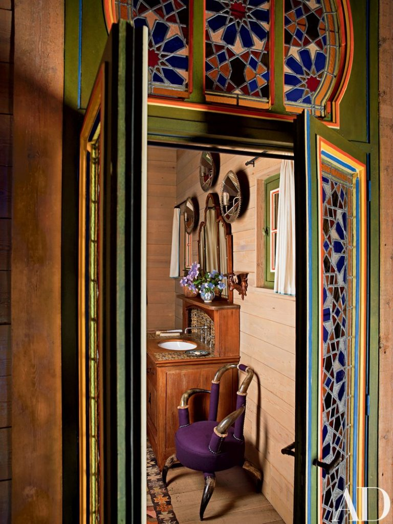 Peering into the powder room and its 19th century Austrian horn chair. (Photo: Pascal Chevallier)