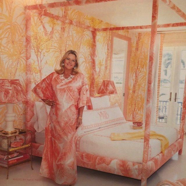 Meg Braff wearing a caftan matching the custom bed in her Kips Bay Show House bedroom.
