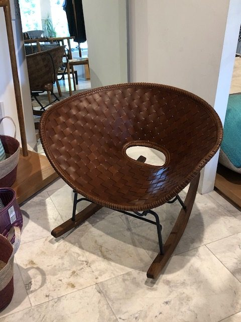 A modern very comfortable leather woven rocker at Lago.