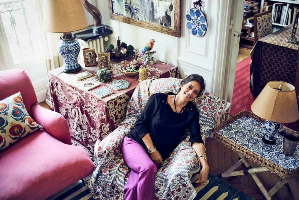 The fabulous Carolina Irving at home among her found and self-designed fabrics. (Photo: Architectural Digest)