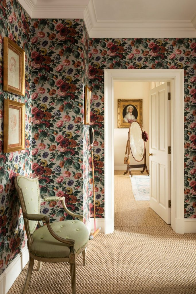Dahlia wallpaper by Flora Soames blankets this hallway in flowery charm.