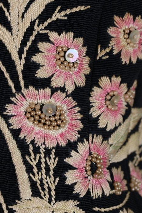 Detail of an Elsa Schiaparelli daisy-embroidered jacket. (Photo: Kerry Taylor Auctions)