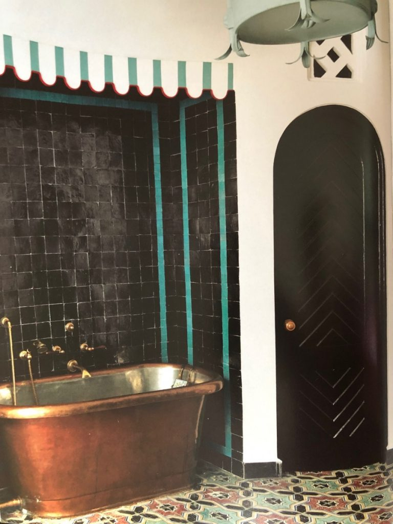 The aqua tile against the black was a brilliant addition that give this bathroom its spark. Dar Hamra. (Photo: Guido Taroni)