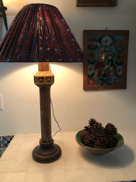 A detail from a Casa V interior. An antique lamp, found at a Paris flea market, with a block printed lampshade.
