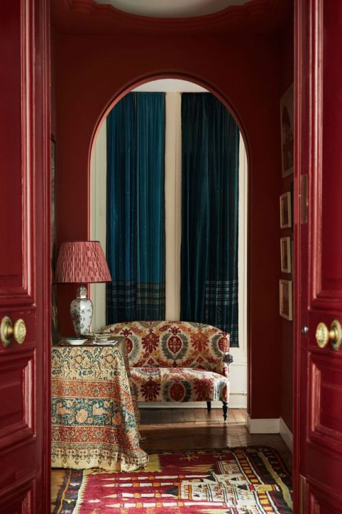 Carolina Irving painted her former Paris home's entry in a deep Moroccan red.