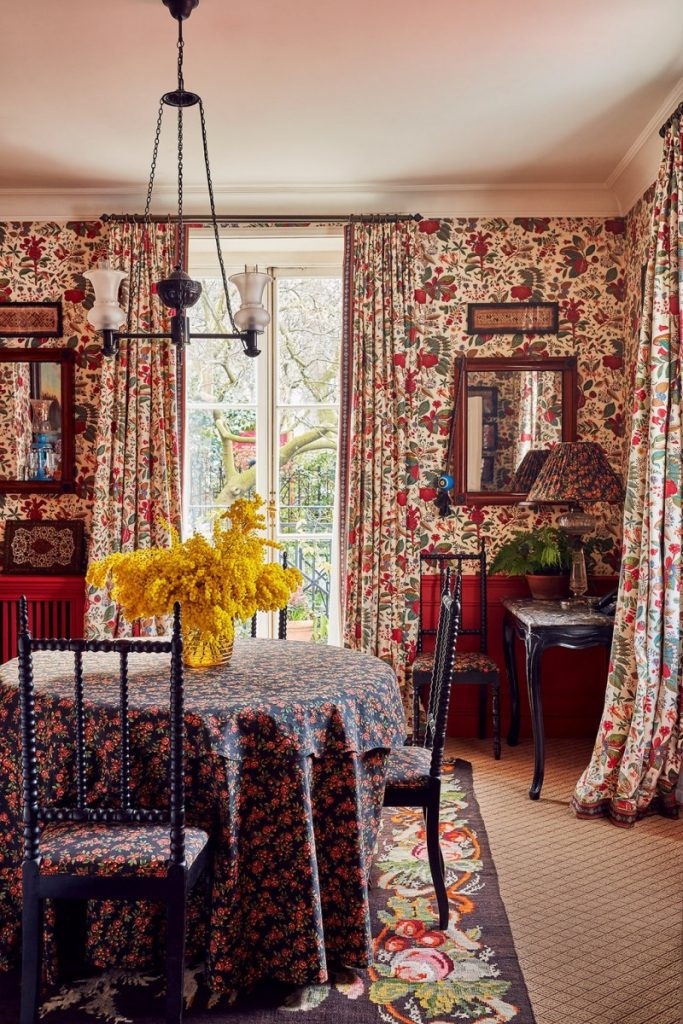 Her dining room walls, tablecloth and chairs are covered in one of her fabrics. (Photo: Dylan Thomas)