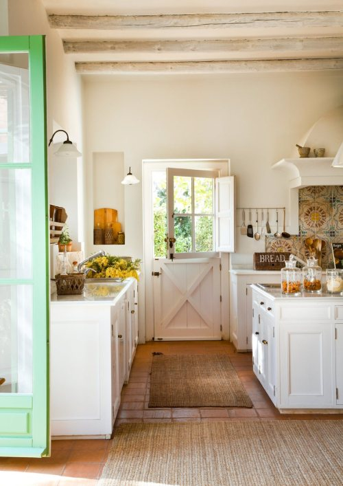 White walls, saltillo floors, and a dutch door make a perfect kitchen. (Photo: Pinterest)