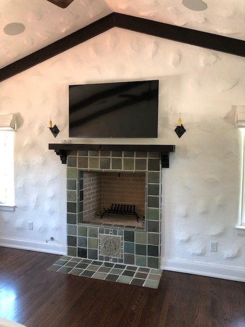 Another unstyled amateur photo of the same house. This fireplace is in the master bedroom.