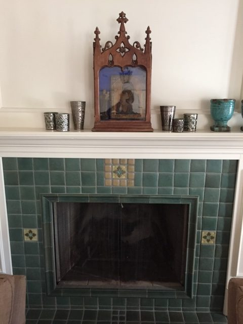 A beautiful lagoon green tile by Laird Plumleigh gives this Winter Park fireplace new life.