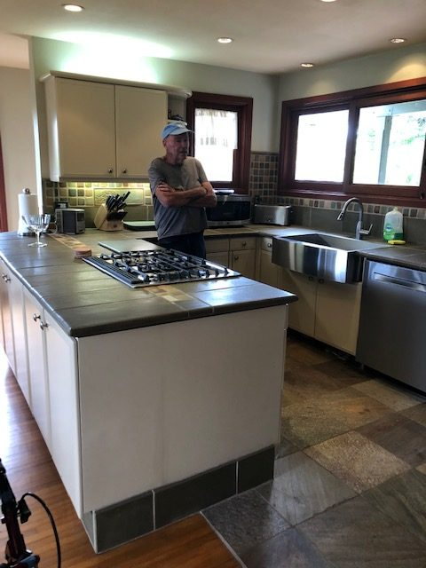 The artist in his newly renovated kitchen.