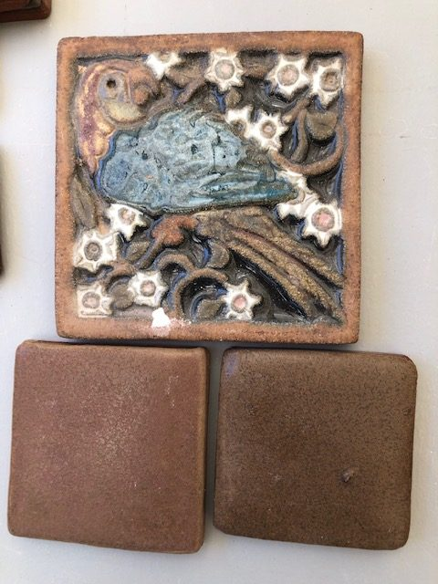 One of my favorite tiles, there are many, is this blue parrot with white cactus flowers.