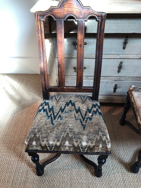 A very worn example on an antique chair seen in Atlanta.