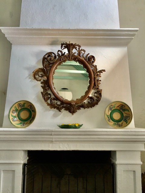 Not entirely sure these bowls adorning the fireplace are considered lebrillos but the placement is typically Spanish.